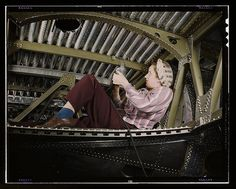 Palmer, Alfred T.,, photographer.  An A-20 bomber being riveted by a woman worker at the Douglas Aircraft Company plant at Long Beach, Calif.  1942 Oct.   1 transparency : color.  Notes:  Title from FSA or OWI agency caption. Transfer from U.S. Office of War Information, 1944.  Subjects:  Douglas Aircraft Company  Bombers Airplane industry Women--Employment World War, 1939-1945 Assembly-line methods United States--California--Long Beach   Format:  Transparencies--Color  Rights Info:  No…
