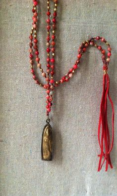 Long Knotted Necklace with Rust to Pink Agate Beads and Thai Buddhist Amulet Pendant