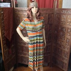 Super comfy v-neck maxi dress, wrinkle-free & fun! XL tribal print maxi dress, short sleeves, stretchy, ties at the waist, length is below the knee- polyester/spandex combination, wrinkle-free, so great for travel! Luv Collection Dresses Maxi