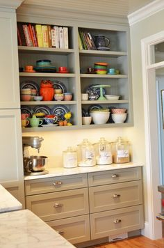 Beautiful kitchen shelves.  I have room at the end of one wall of cubbords that I bet the hubby could build me one column of these shelves.  A place for Cookbooks?!