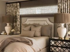 """To give this master bedroom an infusion of Hollywood chic, designer Jennifer Leonard layered rich patterns and textures on the bed. Adding """"jewelry"""" was the piece de resistance, she says. """"The accent pillows have elegant embroidery and glass beading,"""" she notes. These are the finishing touches that lend a hint of sparkle and shine."""