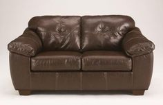 Ashley San Lucas 8370235 70 Stationary Faux Leather Wood Frame Loveseat with Tufted Back Cushions Stitching Details and Plush Padded Arms in -- Check out the image by visiting the link-affiliate link. #LvingRoom Sofas