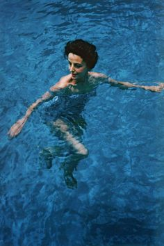 Gloria Guinness photographed by Slim Aarons swimming in her pool, Palm Beach, Florida, 1959.