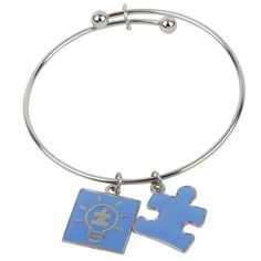 Light It Up Blue Wire Charm Bracelet. Every purchase helps to fund the advocacy of AutismSpeaks.
