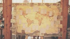 Rustic world map wedding table plan | Images by http://www.costasisterproductions.co.uk/