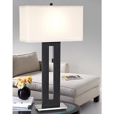 """Right Angle Table Lamp $100      Right Angle Table Lamp.     Modern and contemporary lamp profile.     Black finish metal body.     Brushed nickel base.     White shade.     Takes one 100 watt bulb (not included).     27 1/2"""" high.     Shade is 7"""" deep, 15"""" wide, 9"""" high."""