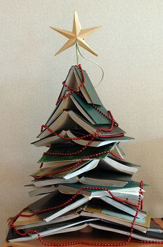 Eco Christmas tree | Search for books with green covers for an original Christmas tree.  Advantages: it will not dry out, no dirt on carpet, cheaper and does not need too much effort to be carried or to be arranged. It is an interesting and mysterious Christmas tree, full of knowledge which has its own stories hidden under the green covers.