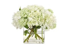 A simple arrangement of creamy white hydrangea. Modern and refined, simple and spectacular. Order Hydrangea Cube Fresh Arrangement from SHADELAND FLOWER SHOP - Indianapolis, IN Florist & Flower Shop. Hortensien Arrangements, Silk Flower Arrangements, Flower Vases, Fake Flowers, Artificial Flowers, Silk Flowers, White Flowers, Spring Flowers, Decoration Table