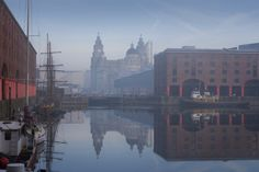 Maritime Albert Dock on Liverpool waterfront with the Three Graces historic buildings all part of the Liverpool world heritage site
