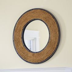 Birch Lane Rope Mirror, Round - A round mirror framed by spiraled lengths of rope and bordered by riveted black metal, this intriguing piece brilliantly bridges industrial and nautical styles.