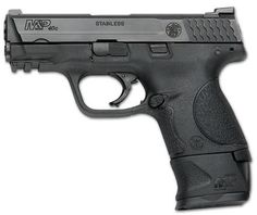 S&W M&P 40 Compact.....I must get one! Find our speedloader now! http://www.amazon.com/shops/raeind