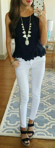 Peplum black top with scalloped hem, white skinnies, black sandals.
