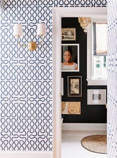 Pictures to the floor are not overwhelming with black wall & all else white.