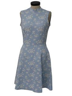 70s -Moody Street- Womens sky blue and white polyester sleeveless mid length knit dress. A textured flower pattern, with a flared skirt, fitted waist, stand up collar and back zip closure.