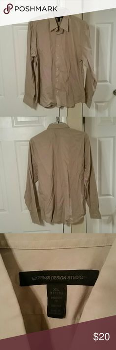Express Modern Fit Stretch Cotton Button Shirt XL An Express Modern Fit Stretch Cotton Button Shirt. Size. XL. Color is tan or beige. Worn a couple times in very good condition.  Good to wear at work or out on the town. Email me if interested. Thanks! Express Shirts Dress Shirts