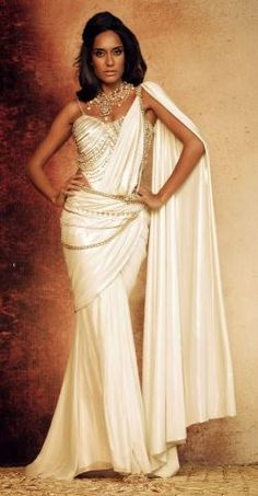 Beautiful designer sari. She looks like a goddess in that to me