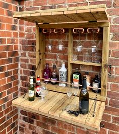 Designed and handmade by The CopperMill Workshop, this amazing garden wall bar is perfect to fulfil your at home bar needs this summer. Created using tantalised timber, the bar stores your favourite drinks before folding down to provide a handy serving table. In the true style of The CopperMill Diy Außenbar, Diy Outdoor Bar, Outdoor Wooden Bar, Pallet Table Outdoor, Outdoor Pallet Projects, Backyard Bar, Pallet Furniture, Furniture Ideas, Wooden Garden Furniture
