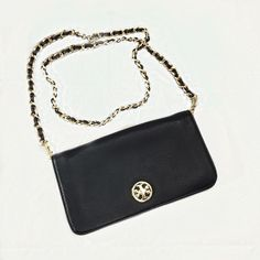 """Tory Burch Black Crossbody / Shoulder Bag Gorgeous Tory Burch black leather crossbody with gold metal accents. Foldover flap with turnlock closure. Interior zippered pocket and divider. Leather and gold metal crossbody strap with 21"""" drop.  Great condition!  9 1/2"""" W X 5""""H X 1/2"""" D Tory Burch Bags Crossbody Bags"""