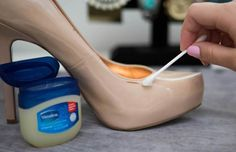 Fix scuff marks on patent shoes by rubbing the spots with petroleum jelly.