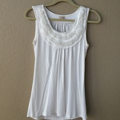 Cremieux White Tank with Ruffle Detail White Cremieux Tank with beautiful ruffle detail (see picture) Size Small. Excellent condition. You need this staple in your closet! Can be dressed up or down! Cremieux Tops Tank Tops