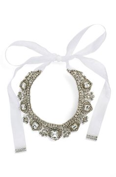 This glistening collar necklace is embellished with rows of prong-set crystals and light-catching jewels. This piece is sure to make a statement when paired with a black dress and pumps.