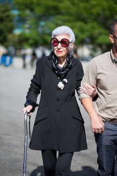 Iris Apfel looks classic as always in these oversized sunglasses and all black outfit. See all the street style looks from day 5 of NYFW here: