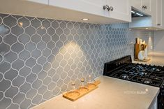 Hampton Inspired Kitchen with mosaic tiled splashback and Silestone Benchtop. Designed By Interior Blank