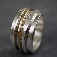 Personalized spinner ring made from sterling silver and solid 10k gold. $138.00, via Etsy.