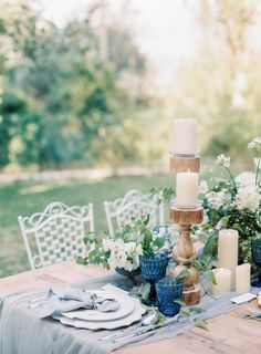 Photos by Romina Schischke Photography. Intimate garden wedding in Italy. Floral Centerpieces to die for! White and blue wedding flowers.
