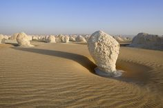 Photo by Sergei Zalivin. The White Desert is a national park of Egypt and is located 45 km (28 mi) north of the town of Farafra. The desert centerpiece is its rock colored from snow-white to cream color.