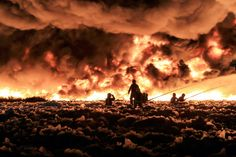 John MccNaughton / West Midlands Fire Service via EPA West Midland firefighters tackle a large blaze at a recycling plant called J & A Young, Dartmouth Road, Smethwick, England on July 1, 2013. More than 150 firefighters worked on the blaze involving 100,000 tons of plastic recycling material sending a plume of smoke is rising 6,000 feet into the air.