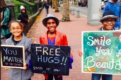 """Devonte Hart ( the 12 year old boy in the famous """"police officer hugs young protester photo""""), holding a """"Free Hugs"""" sign. Also, look at his Awesome little friends!"""