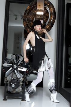 Haute couture, car engine Hispano Suiza type 68 (1933) and light sculpture of black rock cristal by Regis Mathieu. Galerie Lumieres