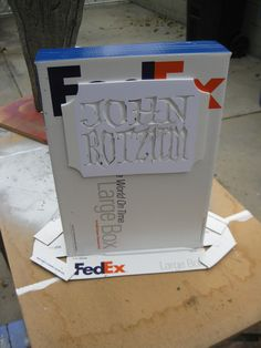 "Oh my goodness...brilliant. The Fed-Ex Box Gravestone ""How To"""