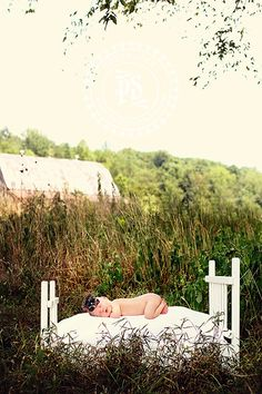 baby on a bed outside #newborn photography