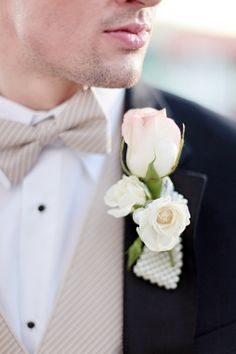 I suspect that Rob will have no part in picking the flowers for the wedding, but spare a thought for what he's supposed to wear on his lapel. This, I think, is a bit much.