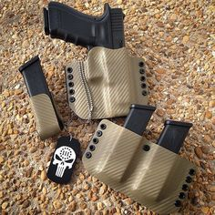 Flat Dark Earth Carbon Fiber gun holster set for Glock 22. Featuring our 3 percenter punisher tag. Eclipseholsters.com