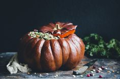 Holiday Stuffed Pumpkin with Wine Soaked Millet, Mushrooms, Almonds, Goat Cheese & Cranberries