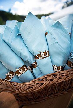 Brides.com: . Décor Inspiration for a Rustic Destination Wedding  Montana sky-blue napkins accented with horseshoe details offered a nod towards this couple's chosen destination wedding venue, Montana's Ranch at Rock Creek.  See more photos from this couple's ranch destination wedding.