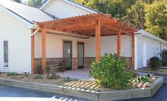 Pergola with Entrance Door to left and Exit Door to right at Appalachian New River Veterinary Associates, 218 Wilson Drive, Boone, NC 28607, Telephone: 828/264-5621