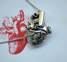 Anatomical Heart Necklace - look, look, look! The heart to go with the rib cage! Super cute AND it opens up!
