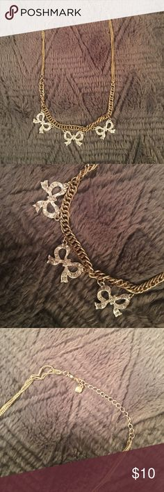 Lauren Conrad statement necklace Gold chain wth adjustable length and lobster claw closure. Three silver bows with rhinestone details. Sits on neck, around collarbone. Great for special occasion or to dress up a tshirt. No trades. LC Lauren Conrad Jewelry Necklaces