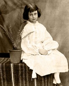 """Alice Liddell, the """"Real"""" Alice who inspired the one in Wonderland. Photographed at age 7, by Charles Dodgson AKA Lewis Carroll in 1860."""