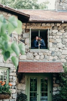 Must have couples photo - enchanting kiss outside the window surrounded by stonework and greenery. Willowdale Estate, a weddings and events north of Boston, Massachusetts. WillowdaleEstae.com | Erica Ferrone Photography
