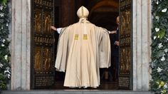 """Pope Francis opens St Peter's Holy Door to launch jubilee 12.08.15 Pope Francis pushes opened the huge bronze Holy Door of St Peter's Basilica in Rome to launch the Catholic Church's """"Year of Mercy""""."""