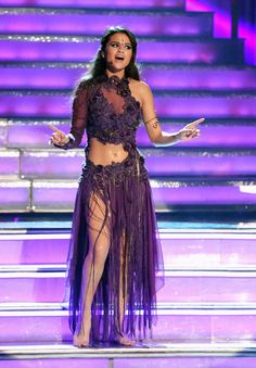 (Task) (fc:Selena Gomez)Ariana; Hi everyone I was dancing and singing which was harder than I thought. I feel like I did pretty good. I hope everyone enjoyed it. I also want to thank my maids for designing the dress I'm wearing.