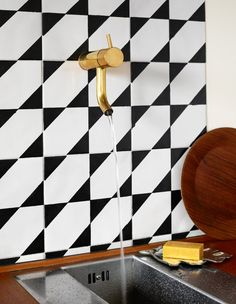 awesome tile work with luxe gold fixture--repin via Bruna Lourenço