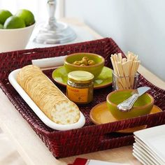 Place appetizers on a wicker tray to make them easy to transport from inside to outdoors. More tips for organizing party food: http://www.bhg.com/party/birthday/themes/how-to-organize-outdoor-party-food-and-drinks/?socsrc=bhgpin080112wickerappetizertray#page=7