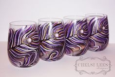 Set of 4- Hand Painted - Stemless Wine Glass: Peacock Design Purple-Black-Gold-White. $150.00, via Etsy.