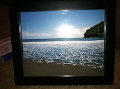 Shadow box frame with beach picture and sand... Hot glue the frame shut so nothing leeks out